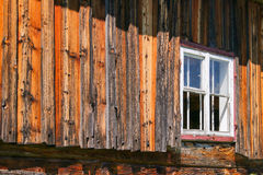 Weathered barn with white window frame Royalty Free Stock Photography