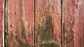 Weathered Barn Wood painted red fading old grey Stock Images