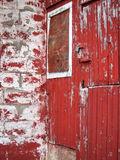 Weathered Barn Wood painted red fading old grey Royalty Free Stock Images
