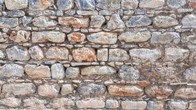 Weathered befleckte alte Steinbacksteinmauer Lizenzfreies Stockfoto