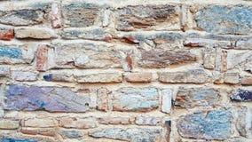Weathered befleckte alte Steinbacksteinmauer Stockfotografie