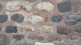 Weathered befleckte alte Steinbacksteinmauer Lizenzfreie Stockfotos