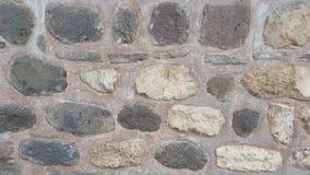 Weathered befleckte alte Steinbacksteinmauer Lizenzfreie Stockbilder