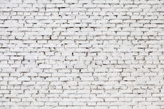 Weathered befleckte weiße Backsteinmauer, Beschaffenheitsschmutzhintergrund Lizenzfreies Stockbild