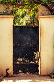 Weathered black garden door Royalty Free Stock Images