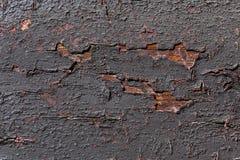 Weathered black painted wood. Royalty Free Stock Image