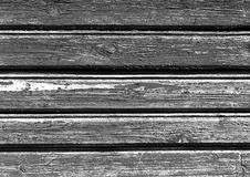 Weathered black and white color wooden house wall. Royalty Free Stock Image