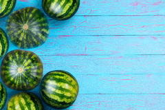 Weathered blue background with round melons Royalty Free Stock Photography