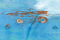 Weathered blue boat hull. With peeling paint Stock Images