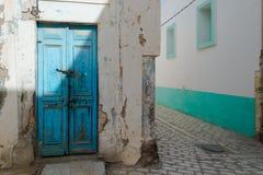 Weathered Blue Door. Battered Blue Front Door in Tunisian Street Royalty Free Stock Image