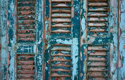 Weathered blue shutters Stock Photos