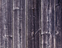 Weathered blue wooden fence texture with nails. Stock Photo