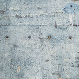 Weathered board with old blue paint and bolts Royalty Free Stock Photo