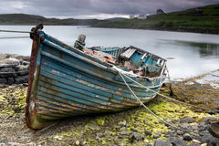 Weathered boat on beach Royalty Free Stock Image