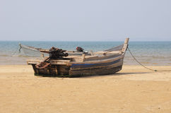 Weathered boat on a beach Royalty Free Stock Images