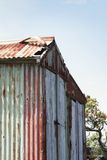 Weathered boat shed. On a shore in New Zealand royalty free stock image