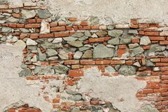 Weathered brick and stone wall Stock Images
