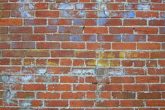 Weathered Brick Wall #2. A close up view of a weathered brick wall with crumbling paint stock images