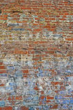 Weathered brick wall. Abstract background of weathered red brick wall with faded paint or graffiti Stock Photos