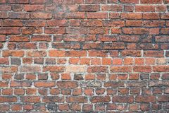 Weathered brick wall. For background use stock photo