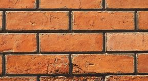 Weathered brick wall with grout joints. Close up of weathered brick wall with grout joints Stock Image