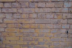 Weathered brick wall with remains of paint. Texture Royalty Free Stock Images