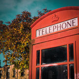 Weathered British Phone Booth. Classic Red Phone Box On A British Street Stock Photo