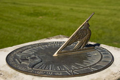 Weathered bronze sundial shows the time Royalty Free Stock Images