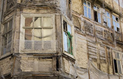 Weathered Building. Ruins of an old deteriorated building in need of a renovation Stock Photos