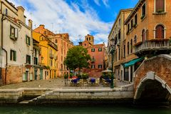 Weathered building facade on a picturesque square in Venice Ital. Venice, Italy - September 25, 2017: Typical view of a square full of weathered buildings and royalty free stock photos