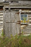 Weathered cabin door and windowsill Royalty Free Stock Images