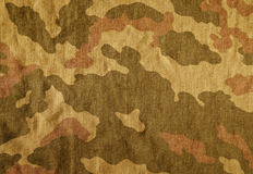 Weathered camouflage cloth texture. Royalty Free Stock Photo