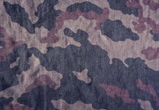 Weathered camouflage cloth texture. Stock Image
