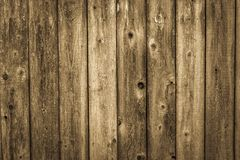 Weathered cedar wood siding background. Old weathered vintage rough brown cedar wood out building siding background stock images