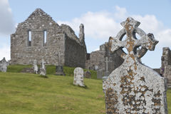 Weathered Celtic Cross at Clonmacnoise monastic site Royalty Free Stock Photos