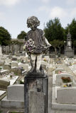 Weathered cemetery old child statue Stock Photography