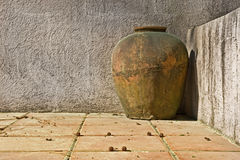 Weathered clay vase on patio Royalty Free Stock Photography