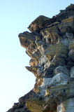 Weathered cliff. Jagged and weathered sedimentary rocks on the cliffs of Noss in the Shetland Islands Royalty Free Stock Photography
