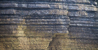 Weathered cliff wall detail Stock Images