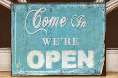 Weathered come in we're open sign Royalty Free Stock Photography