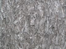 Weathered Compressed Wood. Weathered compressed grunge wood textured panel stock image