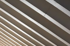 Parallel concrete roof beams letting in light in public space Royalty Free Stock Photo