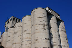 Weathered concrete silos. Group of weathered concrete silos stock photography