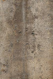 Weathered Concrete Wall. Closeup of the texture on a weathered concrete wall. Vertical shot Stock Images