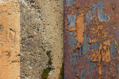 Weathered concrete wall and rusty sheet metal Royalty Free Stock Photos