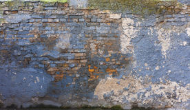Weathered cracked blue wall with white stains Stock Images