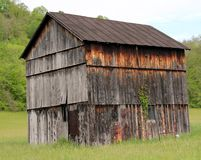 Weathered crooked barn Royalty Free Stock Image