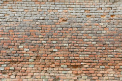 Weathered and damaged brick wall texture Royalty Free Stock Photo