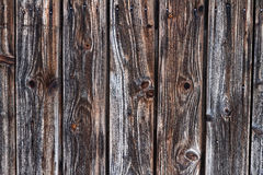 Weathered Dark Lattice Fence Wood Background. Closeup of nailed up and weathered old dark barn door made of pinewood royalty free stock photo