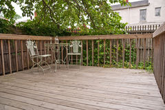 Weathered Deck and Vintage Bistro Table Stock Photos
